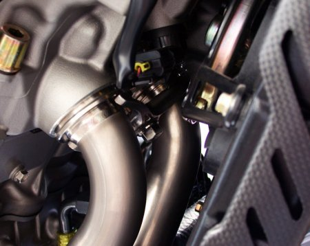 Titanium Exhaust Manifold Flanges by MotoCorse